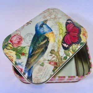 fugleeske med sommerfugl- og rosedekor